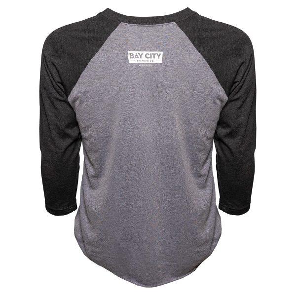 Back of t-shirt with logo badge printed below collar